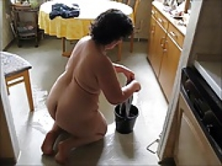 Mature German Lady Cleaning Butt Naked